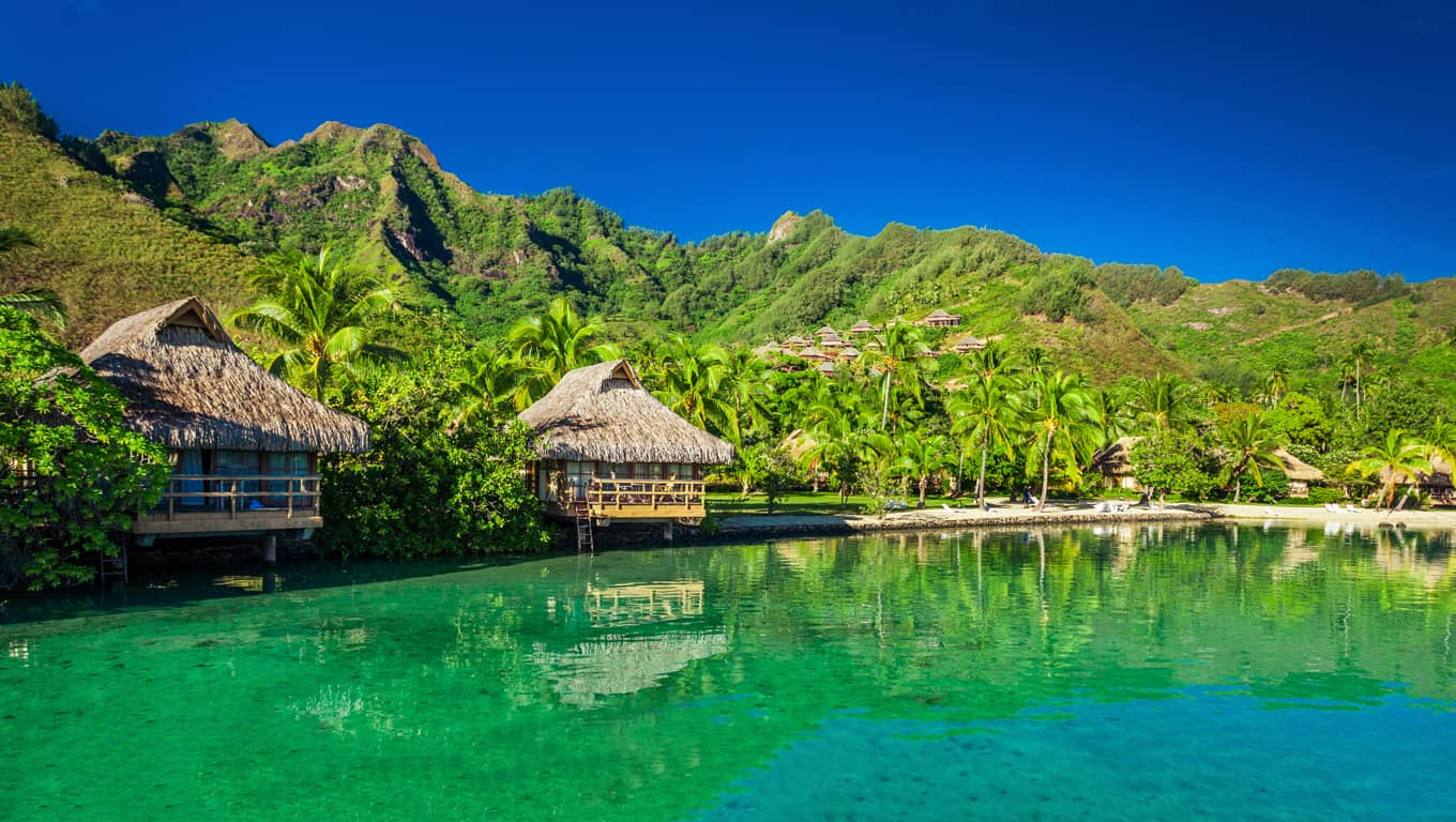 Overwater Bungalows In A Lagoon - Moorea, French Polynesia