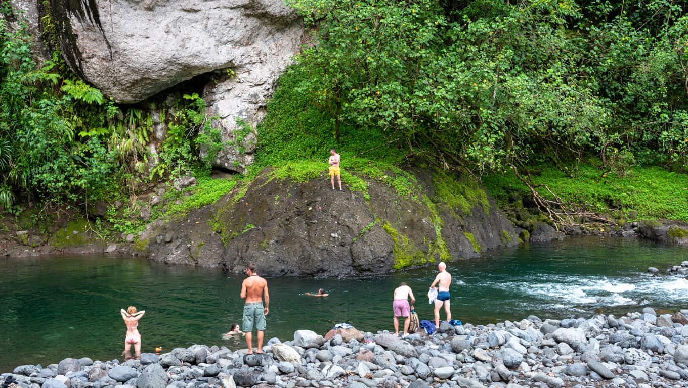 Hikers Swimming In A River - Tahiti, French Polynesia